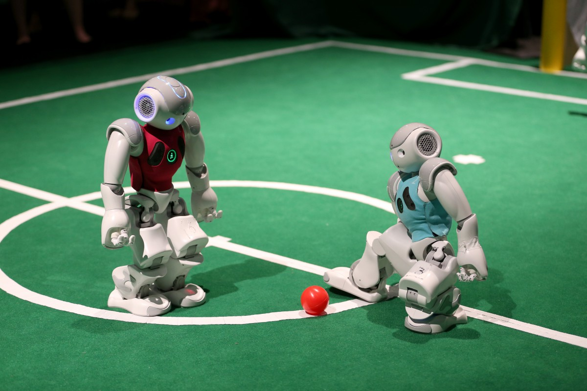 MIAMI BEACH, FL - MAY 06:  Robots from the University of Miami, College of Arts and Sciences' Department of Computer Science play a game of soccer at the eMerge Americas Techweek held in the Miami Beach Convention Center on May 6, 2014 in Miami Beach, Florida.  The eMerge conference brought together more than 100 speakers from large technology companies and emerging ventures throughout South Florida and Latin America as well as gave people hands on experience with robots, video games and other high tech ventures.  (Photo by Joe Raedle/Getty Images)