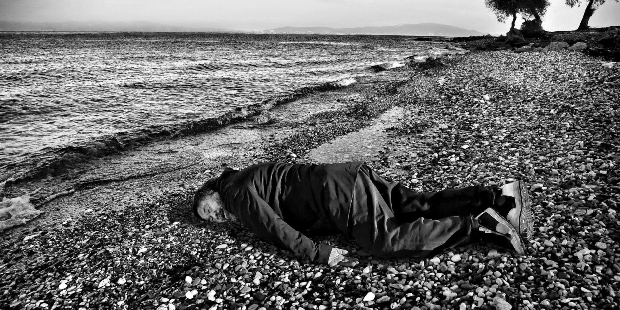 This Jan. 25, 2016, image provided by the India Today news magazine shows Chinese artist and activist Ai Weiwei posing as he lies face down on the beach on the Greek island of Lesbos. Chinese artist Ai Weiwei has recreated the famous image of a 3-year-old Syrian child who drowned in Turkey last year by staging a photo of himself lying face down on a beach in Greece. The photograph last year of the child lying on a Turkish beach triggered international outrage as people saw the helpless toddler as the devastating human face of the refugee crisis in Europe. (Rohit Chawla/India Today via AP) NO ARCHIVE, NO LICENSING, MANDATORY CREDIT